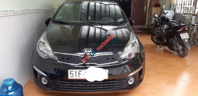 Cần bán xe Kia Rio AT sản xuất 2015, màu đen