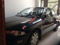 Cần bán gấp Mitsubishi Proton đời 1997, màu đen, nhập khẩu nguyên chiếc