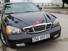 Cần bán lại xe Daewoo Magnus 2.0 đời 2004, màu đen
