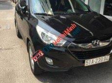 Tôi bán xe Hyundai Tucson AT đời 2011, màu đen số tự động, giá tốt