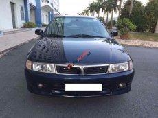 Xe ô tô 5 chỗ Mitsubishi Lancer đời 2001, màu xanh đen
