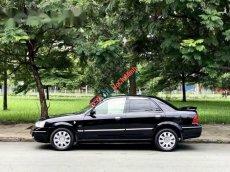 Bán Ford Laser 1.8AT đời 2003, màu đen còn mới