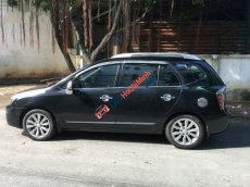 Bán Kia Carens AT đời 2012, màu đen đã đi 40000 km
