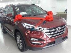 Cần bán Hyundai Tucson 2.0 AT 2WD đời 2013, màu đỏ giá cạnh tranh