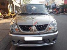 Cần bán Mitsubishi Jolie 2.0MPI đời 2004, màu vàng xe gia đình, giá tốt