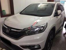 Cần bán xe Honda CRV 2.4 tự động 2014/2015 màu trắng, odo 15 ngàn km