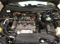 Bán xe Ford Laser 1.8 sản xuất 2003, màu đen, giá 215tr