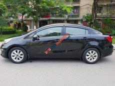 Cần bán Kia Rio AT đời 2015, màu đen, nhập khẩu nguyên chiếc