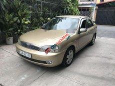 Cần bán lại xe Ford Laser 1.8 MT sản xuất năm 2002, màu ghi vàng