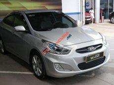 Bán ô tô Hyundai Accent blue 1.4AT đời 2013, màu bạc