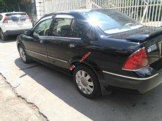 Cần bán xe Ford Laser năm sản xuất 2004, màu đen xe gia đình