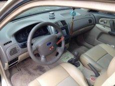Cần bán Ford Laser 1.8 sx 2005, số sàn, màu vàng cát
