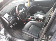Bán Chevrolet Cruze LS màu đen, số sàn, sản xuất 2012 biển Sài Gòn, đi đúng 80.000km, xe rất đẹp