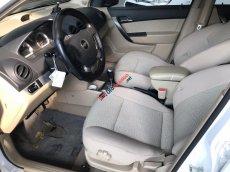 Bán Chevrolet Aveo LTZ 1.5AT màu trắng, số tự động, sản xuất T12/2014, biển tỉnh, 1 chủ, đi đúng 32000km