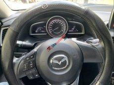 Cần bán xe Mazda 3 1.5 sản xuất 2015, màu trắng còn mới