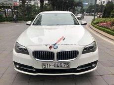 Cần bán BMW 520i sản xuất 2014 màu trắng kem cửa hít, biển TP, xe 1 chủ từ đầu nên rất giữ gìn