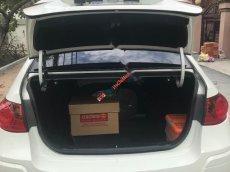 Cần bán xe Hyundai Avante 2.0 sản xuất 2014, màu trắng xe gia đình