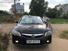 Tôi cần bán chiếc Honda Civic đời 2010, màu đen, số tự động, bản 2.0, odo 94131 km
