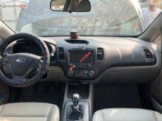 Cần bán Kia K3 1.6 MT sản xuất 2015, màu đen, giá chỉ 448 triệu