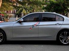 Bán BMW 320i Sportline 2014 màu bạc chính chủ