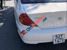 Bán xe Kia Spectra MT sản xuất 2005, màu trắng, nhập khẩu nguyên chiếc, máy lạnh rất lạnh