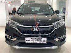Bán xe Honda CR V 2.4, AT sản xuất cuối 2015, bản full opition, màu đen, xe còn rất mới, rất đẹp