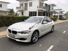 Cần bán xe BMW 3 Series 320i năm sản xuất 2014, màu trắng, giá chỉ 860 triệu