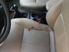 Cần bán lại xe Kia Spectra sản xuất 2004, màu trắng, nhập khẩu nguyên chiếc