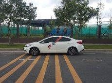 Chính chủ bán xe Kia K3 2.0 AT đời 2015, màu trắng, full options