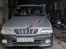 Gia đình bán xe Ssangyong Musso 2002, màu bạc, nhập khẩu