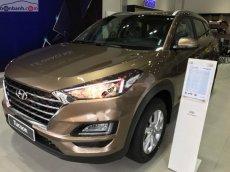 Cần bán Hyundai Tucson 2.0 AT sản xuất 2019, màu vàng