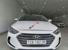 Cần bán gấp Hyundai Elantra 1.6AT 2016, màu trắng xe gia đình