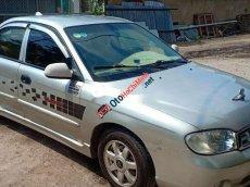 Cần bán gấp Kia Spectra 2004, màu bạc xe nguyên bản
