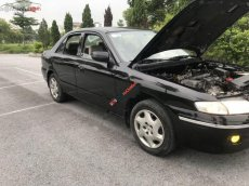 Bán ô tô Mazda 626 2.0 MT năm 2000, màu đen số sàn, giá tốt