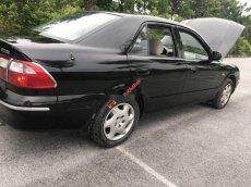 Bán Mazda 626 2000, màu đen, nhập khẩu, 150tr