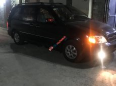 Bán xe cũ Kia Carnival LS 2.5 MT 2007, màu đen, 265 triệu