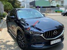 Cần bán gấp Mazda CX 5 đời 2018, màu xanh