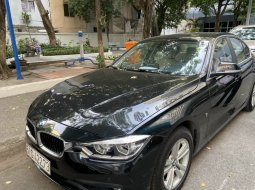Bán xe BMW 320 màu đen, sx 2017 như mới